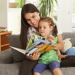 Woman Reading to a Child