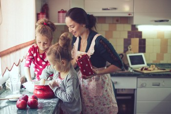Nanny and children in the kitchen